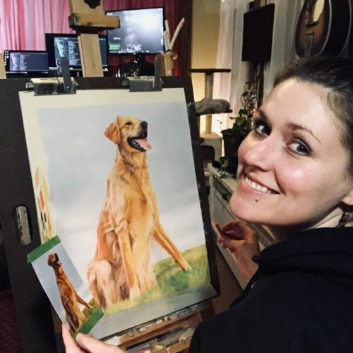 Photograph of Bails Art artist, Brittany, drawing a portrait of a dog