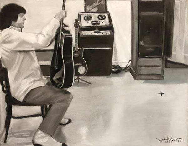 """Black and white drawing in chalk pastel of a man sitting in Elvis' studio. The man is sitting on a chair holding a guitar and in the background you can see music equipment, another guitar and an """"x"""" on the ground which marks the spot Elvis stood in."""